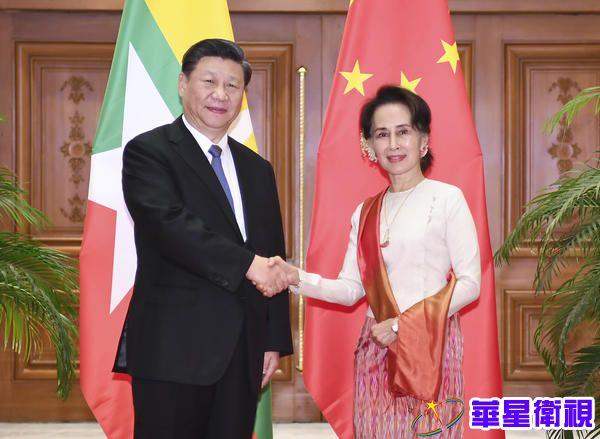 习近平同缅甸国务资政会谈